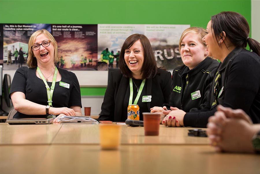 Photograph of Asda employees having a meeting.
