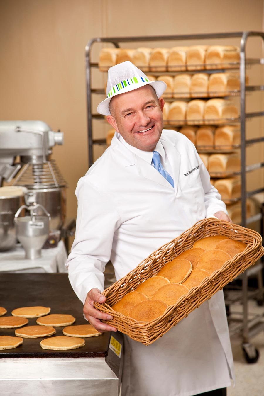 A portrait of a baker in a bakery setting.