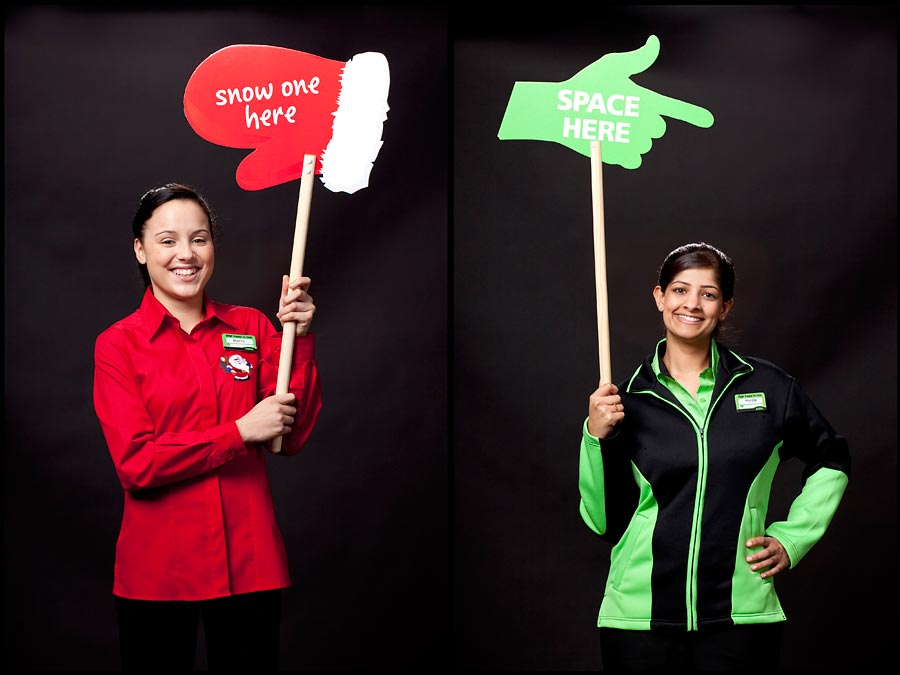 Two images of Asda employees holding up signs.