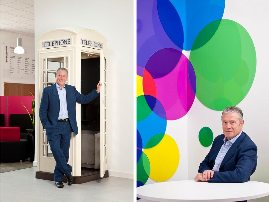 Two images. The one on the left is a man holding open the door of a white telephone box inside a building. The second is the same man sat at a desk against the backdrop of round circles of colour.
