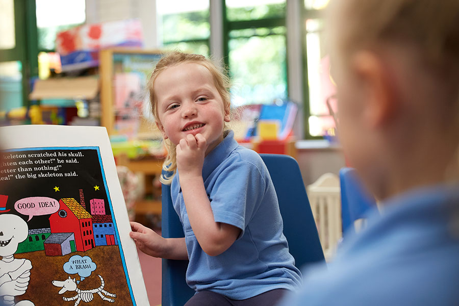 AESG-school-pone young student reading a large book to another.hotography-prospectus-cheshire-Photographer-_MG_8623