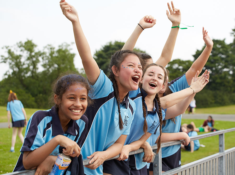 students happy and cheering a race at sports day.