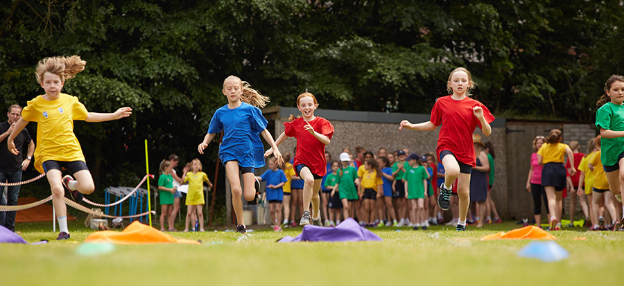 sports day. young students running a race